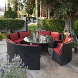 Meridian All-Weather Wicker Patio Dining Set with Cushions - Seats 8 - Mix up some mojitos or a refreshing pitcher of lemonade grab some friends and prepare yourself for a night of fun and relaxation around the Meridian All-Weather Wicker Patio Dining Set with Cushions - Seats 8. This head-turning contemporary set centers around a round dining table constructed of a lightweight frame of rust-proof aluminum with PVC-board top and an all-weather wicker exterior with glass top. It's perfect for meals or informal get-togethers. As for seating four cushioned benches offer a comfortable spot for eight people. Each bench is one quarter of a full circle creating a round seating area that specializes in bringing people together. Each bench has a corrosion-resistant aluminum frame that's covered in all-weather wicker and a set of matching cushions in choice of colors that will add the comfort you need outdoors. Choose from two cushion fabrics: Olefin or Sunbrella. About Belham Living Belham Living builds catalog-quality furniture in traditional styles at a price that actually makes sense. By listening to our customers and working closely with great manufacturers we build beautiful pieces worthy of your home. Rich wood finishes attention to detail and stylish lines that tie everything together are some of the hallmarks of a Belham Living piece. From the living room or bedroom through the kitchen and out onto the deck there's something from an incredible Belham collection perfect for your style.