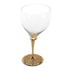 Merdinger House Of Design - Water Glass - Replenish your body and soul with essential water served from the Arabesque collection's Water Glass. Formed uniquely with mouth blown glass, this Water Glass is finished with a striking Arabesque patterned stem. This stem itself is sublimely plated with 18 K gold and titanium.