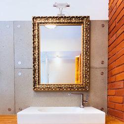 Custom gold frame bathroom mirror - The finish has a dark gold with light gray wash.