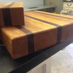 Soapstone Werks - It is that time of year where everyone is buying presents. Here at Soapstone Werks we offer beautiful wood cutting boards. Each one is unique and full of interest.  They are made by our favorite master wood crafter. These cutting boards make every kitchen look deluxe. Please call 760-739-0655 to get a gift anyone would love!