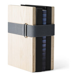 MENU - Book Binder, Oak, Large - What a brilliant solution for organizing a classic set of books, magazine collections or even vintage albums. You can keep an entire collection together with the adjustable elastic strap and display it anywhere in the house. This would be great in a kitchen or dining room with cookbooks.