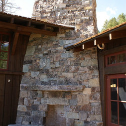 Lake Cabin - Greenwood Masonry Construction, Whitefish  ,Montana, Outside Fireplace with rustic stone, Boulder Hearth and stone mantel