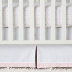 Serena & Lily - Colette Crib Skirt - Peek-a-boo box pleats reveal pops of grey, giving subtle depth to our mostly-white crib skirt. A pale pink trim adds a delicate finish.