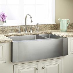 """33"""" Optimum 70/30 Offset Double-Bowl Stainless Steel Farmhouse Sink - Wave Front - Great for busy kitchens, this stainless steel double well sink features a large, deep well and a smaller, shallow well that's perfect for prep jobs. The sleek, brushed finish and apron front will blend perfectly in a contemporary kitchen."""