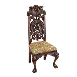 "EttansPalace - Hand-Carved Solid Mahogany Antique Replica Manor Chair - Hand-carved solid mahogany antique replica; Boasting an extremely deep hand carved back and legs with dragons, lions, and green men, this stunning work of mahogany furniture art takes a master carver a full week to complete. In an English manor, claw-footed chairs like this replica were traditionally reserved for the master of the house and distinguished guests. The comfortably padded, 8-way hand tied seat is smartly upholstered in shades of eggplant and gold textured velvet. Whether used as a creative European accent piece or provided at the dining table for all your guests, this Design exclusive is sure to impress. 22.5""W x 20.5""D x 49.5""H. 25 lbs. Floor to top of seat measures 20"""