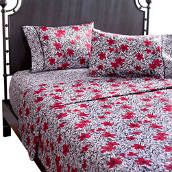 koi Design - Red Poppy Sheet Set - Slumber on a bed of flowers with these dreamy 300-thread count cotton sateen sheets. With a vivid pattern of red blooms on a black and white background, you can add a healthy dose of style to your beauty sleep. Pair them with a geometric wrought iron bed frame for a dramatic yet inviting look.