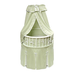 Badger Basket - White Elegance Round Baby Bassinet - Sage Waffle Bedding - The Elegance Bassinet is the most charming and unique place for your newborn to sleep! This special oval bassinet with a white finish is comfortable for Baby and stylish for your home. Sage bedding set (with Ecru Waffle pleats and trim) includes a lovely pleated skirt, soft bumper, fitted sheet, and drape canopy and a custom fitted, vinyl covered foam mattress pad.  Also includes caster wheels and storage shelf beneath. The Elite Bassinet can be used for infants up to 20 lbs or until Baby can push up/roll over. Easy assembly with illustrated instructions.