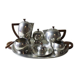 """Pre-owned French Pewter Tea or Coffee Server - Eight-piece pewter service by Etains du Manoir with coffee pot, teapot, dome-covered dish, sugar, creamer, bowl, ladle, and tray. Maker's marks incised under each serving piece.     Dimensions:   coffee pot, 9""""H x 8""""L x 5""""W  teapot, 7.5""""L x 5""""W x 5""""H  dome-covered bowl, 7""""L x 7""""W x 3""""H  sugar, 5""""L x 4""""W x 4""""H  creamer, 3""""L x 4""""W x 3""""H   bowl, 4""""L x 4""""W x 3H  ladle, 5""""L x 2""""W."""
