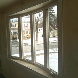 Vinyl Bow Window - Alside vinyl Bow Window w/ two operational units.