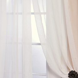 Solid Off White Voile Poly Sheer Curtain - These beautiful and classic solid voile poly sheer curtain panels come two in the set for extra value. These sheer panels are unmatched in quality and design. They create a warm atmosphere with beautiful light diffusion. Each panel is bottom weighted.