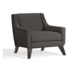 Younger - Lily Chair - Sitting low and relaxed, with a deep, wide seat, sloping arms, and reclining back, this chair invites you to get comfortable. Its sleek modern style and versatile dark gray upholstery make it a smooth, easy choice for your living room.