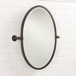 """Sussex Pivot Mirror, Oval, Antique Bronzel finish - The fixtures in four-star hotels were the model for our beveled mirror, built with the finest materials and craftsmanship. 23.5"""" wide x 27"""" high x 4"""" deep Beveled glass is surrounded by a moisture-resistant aluminum frame. Includes mounting hardware. View our {{link path='pages/popups/fb-bath.html' class='popup' width='480' height='300'}}Furniture Brochure{{/link}}. Catalog / Internet Only."""