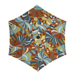 Round Marimekko Spinning Umbrella - This Marimekko umbrella is colorful and fun. The pinwheel design brings a huge burst of color. Matching pillows would transform a dull deck or patio.