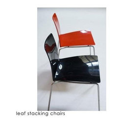 Leaf Chairs By Moroso Of Italy - I love patent leather shoes. Perhaps that's why I'm gaga over this shiny stacking chair. I love the thought of alternating red and black around a round kitchen table or craft table in a playroom.