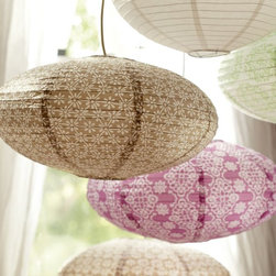 Oval Paper Lanterns - Japanese paper lanterns sporting a miniature floral pattern are a great way to bring the outdoors in.