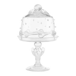 Juliska - Juliska Ursula Tea Cake Dome Pedestal Set Clear - Juliska Ursula Tea Cake Dome-Ped. Set Clear. Juliska glass is mouth-blown by artisans in the hills outside Prague. The techniques they use have been passed down through generations. To watch these skilled glassmakers work is breathtaking. Being handmade, no two pieces of Juliska are identical. Each has its own exquisite, individual character. Uniqueness is valued and guaranteed. Every piece of Juliska glass is individually signed as a hallmark of its origin and authenticity. With such heritage, attention to detail and beauty, it is no wonder Juliska glass is extraordinary.