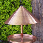 Copper Cone-Topped Birdfeeder - This hammered copper bird feeder is beautiful. The top cone is large and will stand out in your back yard. As always, I'm a sucker for copper and the beautiful patina it will gain over the years. It's almost like buying two different products, knowing what it will turn into.