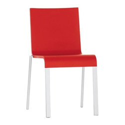 """Vitra - .03 Stacking Chair by Maarten Van Severen - The aesthetic trademark of .03 is its clear simple lines – the quintessence of the concept """"less is more"""". Only when the user sits down do they experience its great comfort. The soft seat and backrest shell made of integral foam support the body when sitting, together with the leaf springs integrated into the backrest. Stack up to 20 of these versatile chairs which will look great in your home or in public spaces! Features: -Integral polyurethane foam shell. -Back with integrated leaf springs. -Powder coated aluminum legs. -Stackable up to 20 chairs high. -Easy to clean. Specifications: -Seat Height: 16.5"""". Design: -Design is the process by which almost all objects in Vitra's surroundings are instilled with a specific design and function - from cars to paper clips, from clothing to chairs. And design does not just mean giving things a shape. Design creates the basis which enables things to function in the desired manner. It is a process in which complementary but often mutually contradictory requirements have to be met (comfort, technology, ergonomics, ecology, economics, aesthetics). Design can be successful only when the balance of all these factors is attained. Quality: -Once in the factory, Vitra staff manufacture furniture to precise standards, individually ensuring the quality of each product. -Vitra has been certified for DIN EN ISO 9001: 2000. -Vitra's focus on quality does not end at the factory door - they believe that providing clients with exceptional service is just as important as manufacturing furniture. In order to make certain Vitra clients enjoy consistently high quality in all Vitra products, they have set up their own test center which monitors products against criteria that are far more stringent than the statutory standards. Ergonomics: -Ergonomics is an applied science that studies the relationship between human beings and machines. Vitra produces furniture that responds to the ergonomic requ"""