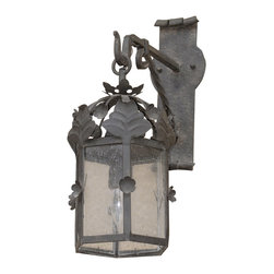 Custom Exterior Iron Lights - Classic and elegant design in this exterior hand forged iron lantern with 1 light. Clear seeded glass, powder coat base and an additional hand applied color finish for that Old World look are elements that are always included in our exterior pieces.