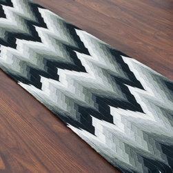 Graphite Runner - With graphite colors and zig-zag shapes, this is the perfect table runner for an urban affair. Just add a fine, colorful dinner and a glass of red wine.