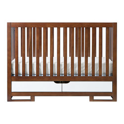 Oslo Modern Baby Crib - I love everything about this crib. The wood makes it feel a little traditional, but the clean lines make it feel modern. Plus, it has storage to boot — win, win, win.