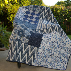 None - Santorini Quilted Throw - This patterned quilted throw pillow is a beautiful addition to your living room decor. Featuring patterns of navy-blue geometric designs and light gray backgrounds, this pillow looks soothing. The woven materials are a comfortable resting place.
