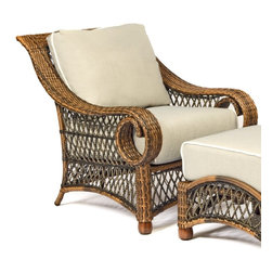 Woodard Belmar All Weather Wicker Stationary Lounge Chair - You don't have to travel long distances or backward spans of time to soak in a little old-world Southern ambiance - all you need is a cool mint julep and the Woodard Belmar All Weather Wicker Stationary Lounge Chair. Crafted with durable weather-resistant resin wicker over a sturdy aluminum frame, this generously sized lounge chair is the spot for elegantly laid-back afternoons on the porch. Classic details include a high curved back, sweeping curled arms, a delicate lattice weave, and a natural light brown finish. Included are plump fabric cushions, available in your choice of colors.Important NoticeThis item is custom-made to order, which means production begins immediately upon receipt of each order. Because of this, cancellations must be made via telephone to 1-800-351-5699 within 24 hours of order placement. Emails are not currently acceptable forms of cancellation. Thank you for your consideration in this matter.Woodard: Hand-crafted to Withstand the Test of TimeFor over 140 years, Woodard craftsmen have designed and manufactured products loyal to the timeless art of quality furniture construction. Using the age-old art of hand-forming and the latest in high-tech manufacturing, Woodard remains committed to creating products that will provide years of enjoyment.Superior Materials for Lasting DurabilityIn the Aluminum Collections, Woodard's trademark for excellence begins with a core of seamless, virgin aluminum: the heaviest, purest, and strongest available. The wall thickness of Woodard frames surpasses the industry's most rigid standards. Cast aluminum furniture is constructed using only the highest grade aluminum ingots, which are the purest and most resilient aluminum alloys available. These alloys strengthen the furniture and simultaneously render it malleable. The end result is a fusion of durability and beauty that places Woodard Aluminum furniture in a league of its own.All Seasons Outdoor Wicker is the latest addition to the Woodard line of quality furniture. Each piece is constructed using cutting-edge synthetic fibers, hand-woven over an aluminum frame. With this combination of resilient, weather-resistant materials and Woodard's quality workmanship, All Seasons Wicker will retain its beauty and integrity for years.Fabric, Finish, and Strap Features All fabric, finish, and straps are manufactured and applied with the legendary Woodard standard of excellence. Each collection offers a variety of frame finishes that seal in quality while providing color choices to suit any taste. Current finishing processes are monitored for thickness, adhesion, color match, gloss, rust-resistance and, and proper curing. Fabrics go through extensive testing for durability and application, as well as proper pattern, weave, and wear.Most Woodard furniture is assembled by experienced professionals before being shipped. That means you can enjoy your furniture immediately and with confidence.Together, these elements set Woodard furniture apart from all others. When you purchase Woodard, you purchase a history of quality and excellence, and furniture that will last well into the future.