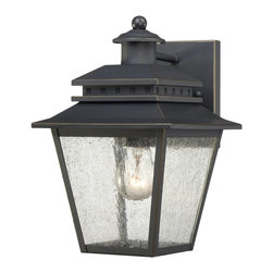 Quoizel - Quoizel CAN8407WB Carson Transitional Outdoor Wall Sconce - The Carson outdoor collection is a classic design that will maintain its beauty for many years.  The design features clear seedy glass that diffuses the light with an ethereal, dreamlike effect and the weathered bronze finish completes the look.
