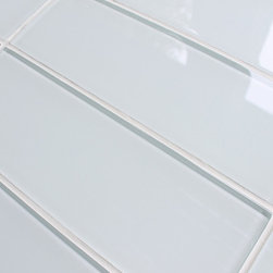 "Rocky Point Tile - 10 Square Feet - Snow White 4"" x 12"" Glass Subway Tiles - 10 square feet of Snow White 4"" x 12"" glass subway tiles. A cool bright white glass subway tile perfect for a kitchen or bathroom in need a bright finish. These tiles come loose packed giving you the option to arrange them in the pattern of your choice. Each tile is back painted and has a high gloss finish."