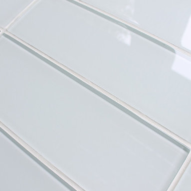 """Rocky Point Tile - 10 Square Feet - Snow White 4"""" x 12"""" Glass Subway Tiles - 10 square feet of Snow White 4"""" x 12"""" glass subway tiles. A cool bright white glass subway tile perfect for a kitchen or bathroom in need a bright finish. These tiles come loose packed giving you the option to arrange them in the pattern of your choice. Each tile is back painted and has a high gloss finish."""