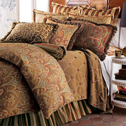 "Legacy Home - Cashmere Ruby Paisley Bed Linens are rich in color with spice-toned paisley and striped patterns. Piped duvet covers reverse from paisley to chocolate. Ruffled striped dust skirts have an 18"" drop."