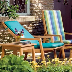 Oxford Garden Siena Reclining Lounge Chairs - Set of 2 - The Siena Reclining Lounge Chairs let you enjoy the comfort of a recliner with the stability of a fixed armchair. A fixed base provides a firm foundation for the easy-to-use reclining mechanism allowing you to choose an angle that is comfortable. Crafted from sturdy shorea wood this armchair set is very similar to a teak one in terms of appearance and durability. Cushions are sold separately. Choose with or without matching ottomans.Shorea Wood: An Eco-Friendly Choice Like teak it's more expensive counterpart Shorea is a high-quality hardwood praised not only for its looks but also for its longevity and resistance to decay. Shorea is hard and dense like teak. In fact it possesses an even tighter wood grain making it heavier denser and harder than teak and both woods are extremely resistant to decay. Shorea wood contains a comparatively high oil content which not only enhances its defenses against the ravages of time and changing climate but also against destructive insect infestations. So if teak and Shorea are so similar why does teak cost up to twice as much? Shorea's lower cost can be attributed to its abundance compared to teak's rarity. This abundance of supply is also what makes Shorea a green choice. Shorea wood is carefully regulated. Only mature trees can be legally harvested. This ensures a steady supply of Shorea wood while also protecting irreplaceable forests. Because Oxford Garden obtains their Shorea wood from superior sources minimal processing is required to bring out the wood's stunning color and grains. This means less chemicals used. Oxford Garden's factories use recycled wood to fuel production kilns. They take steps to conserve natural resources and the result is a smaller carbon footprint. Why Choose Oxford Garden? Exquisite pieces and impressive product assortment aside there are several factors that set Oxford Garden apart from the competition. First Oxford Garden starts with the best Shorea wood sources. This results in more beautiful more durable furniture. The next thing that distinguishes them is their unrivaled craftsmanship. They take pride in meticulous construction of each product. In fact Oxford Garden has a unique multiple quality checkpoint system to be sure you're getting the best. Most of their products go through rigorous consumer safety tests and before they package any product they put it together themselves to ensure it assembles seamlessly for you. Thirdly Oxford Garden believes furniture should be comfortable and attractive. They create ergonomic pieces designed to accommodate the contours of the human body. Finally by using Shorea wood Oxford Garden is able to bring you affordable luxury. Their superb craftsmanship ensures longevity for years of enjoyable use while their incomparable designs are centered on comfort and beauty.