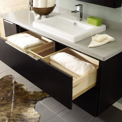 Decora U-Shaped Vanity Drawer - Make the most of limited space. Many of Decora's new bath products feature U-shaped drawers that fit around plumbing so you can utilize every inch of storage.