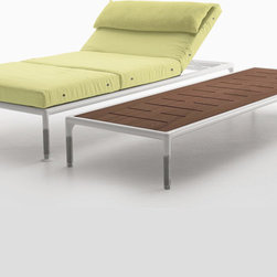B&B Italia Outdoor - B&B Italia Outdoor Springtime Chaise Lounge - This chaise lounge designed by Jean-Marie Massaud is made up of aluminium frames finished in white polyester powder coating. The piece has stainless steel supports, polyester fibre padding and upholstery in water-repellent fabric available in four colors. The chaise lounge comes in two different models: single with wheels or double with reclinable headrests to place parallel or face to face, also with the possibility of placing a table between the two seats. Other accessories match the chairs, such as square and rectangular elements with mahogany tops that can also be outfitted with cushions. Price includes shipping to the USA. Manufactured by B&B Italia Outdoor. Designed in 2008.