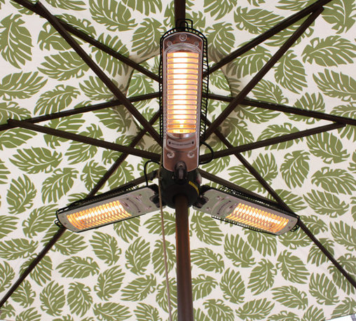 Umbrella Infrared Patio Heater with 3 Heating Heads - Stay warm and cozy under your patio umbrella with this umbrella halogen patio heater. Equipped with three heater heads that resemble fan blades, this patio heater easily attaches to any standard size umbrella pole. Each halogen bulb contains 500 watts of power to give you powerful yet silent warmth. This revolutionary patio heater runs on regular household 110V current to operate at about 1/10 the cost of propane heaters! The frame is constructed of sturdy steel to give durable support to the heater. Simply turn the heater on and enjoy 100 x 37 heat in seconds! Can be used indoors or outdoors.