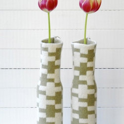 Knitted Vase Cover HARU by Hogenbirk Knitwear - This is such a great idea. These sweet knitted vase covers simply pop over an empty wine bottle and voila! Recycling made pretty. Add some single flower stems and you're good to go.