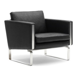 ch101 Lounge Chair - This chair lets the world know that you are cool. Way cool. That's all there is to it. While I'm not usually a huge fan of leather furniture, this sleek modern armchair gets a big fat exception; the way it sits atop those chrome legs is so fabulous, it's almost too much to handle.