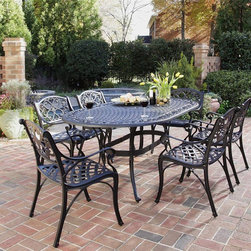 HomeStyles - 7-Pc Oval Dining Set (Black) - Finish: BlackIncludes dining table and six arm chairs. UV resistant, hand applied powder coat finish. Designed to prevent damage caused from pooling by allowing water to pass through freely. Adjustable and nylon glides prevent damage to surfaces caused by movement and provide stability on uneven surfaces. Stainless steel hardware. Made from cast aluminum. Seat height: 15.5 in.. Arm height: 24.75 in.. Chair: 22.83 in. W x 21.65 in. D x 32.68 in. H. Table: 72 in. L x 42 in. W x 28.5 in. H. Warranty. Table Assembly InstructionsHome Styles cast aluminum outdoor dining collection gives you the beauty of ornately designed pieces without the high cost.