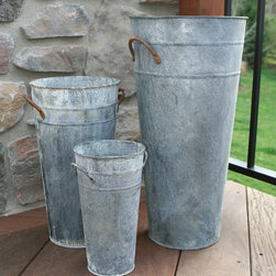 French Flower Buckets, Aged Zinc Finish - Tall, narrow vintage style metal French flower buckets seem aged for years in the garden. These simple flower containers are available in several heights, (starting at $8) and an Aged Zinc finish, which makes it seem like it has been weathered and well-used.  Each has two arched metal handles for carrying. Use a smaller size on a tabletop as a centerpiece vase for fresh cut flowers, or a taller size in the entryway as an umbrella holder.