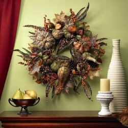 28 in. Autumn Pumpkin Wreath - All the season's bounty comes together in this delightful 28 in. Autumn Pumpkin Wreath. From fruits to feathers this wreath has the autumnal touch in every stem. Hang it from your front door your mantle or on a wall and this wreath will bring the holiday spirit to every part of your home.About Nearly Natural Inc.For over 75 years Nearly Natural Inc. has been providing conscientious consumers with beautiful alternatives to natural decorations. Employing and advised by naturalists who understand the live plant world Nearly Natural is able to recreate the most realistic-looking decorative items for homes offices and businesses. Driven by a true commitment to customer service attention to detail and natural philosophy Nearly Natural strives to bring customers the most beautiful unique and striking faux fauna and flora on the market.