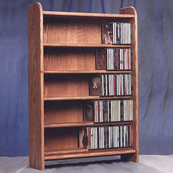"""Wood Shed - 500 Series 275 CD Multimedia Storage Rack - This rack is truly a fine piece of furniture that will enhance your decor while providing easy access storage. This product looks great as it is solid wood and does not have any screws. Features: -Holds 275 CD's.-Commercial Use: Yes.-Material: Solid oak.-Solid Wood Construction: Yes.-Number of Items Included: 1.-Scratch Resistant: Yes.-Heat Resistant: No.-Stain Resistant: Yes.-Drawers Included: No.-Exterior Shelves Included: Yes -Number of Exterior Shelves: 5.-Adjustable Exterior Shelves: No..-Cabinets Included: No.-Distressed: No.-Collection: 500 Series.-Recycled Content: No.-Eco-Friendly: No.-Storage Capacity: 275 CD's.-Country of Manufacture: United States.-Wall Mountable: Yes.Specifications: -ISTA 3A Certified: No.Dimensions: -Overall Height - Top to Bottom: 35.75"""".-Overall Width - Side to Side: 24.25"""".-Overall Depth - Front to Back: 7.25"""".-Drawer: No.-Shelving: -Shelf Height - Top to Bottom (Top) : 5.75"""".-Shelf Height - Top to Bottom (Others) : 5.125"""".-Shelf Width - Side to Side: 23.5"""".-Shelf Depth - Front to Back: 5""""..-Overall Product Weight: 42 lbs.Assembly: -Assembly Required: No.Warranty: -Product Warranty: 6 months."""