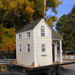 Jacque's Playhouse - This 'Fancy Built' playhouse features pint-sized elegance.  Your new miniature house will put smiles on those sweet little faces.  Imagine the hours of 'playing house!'  They're going to need to borrow your high heels, hats and bow ties.  Be sure to take photos!