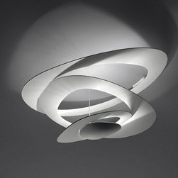 Artemide - Pirce Ceiling Lamp by Artemide - Pirce Ceiling Lamp by Artemide. Ceiling lamp in painted aluminium. Opening out of a slim disk are fluttering spirals, which fall gently downwards, creating magical effects of form and light. Pirce Ceiling Lamp by Artemide are designed by Giuseppe Maurizio Scutellà.