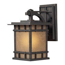 Elk Lighting - EL-45010/1 Newlton 1-Light Outdoor Sconce in Weathered Charcoal - The Newlton Collection projects clean styling and historic character that is carried through the design elements of the frame, arm and backplate. The lantern is constructed of solid cast aluminum, finished in weathered charcoal for long lasting durability. The seeded amber linen glass portrays a warm ambiance to your outdoor environment.