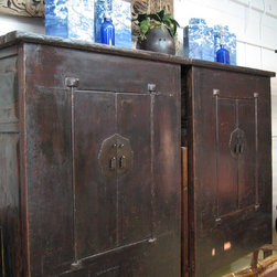 Qing Dynasty Asian Chinese antique large black cabinet pair - Awesome and impressive describes this antique Chinese armoire cabinet pair, which features dense elm wood (Yumu). These rare fabric wrapped 1800's Qing dynasty cabinets usually come in pairs. It is becoming increasingly more rare to find a matching pair and in this great condition.
