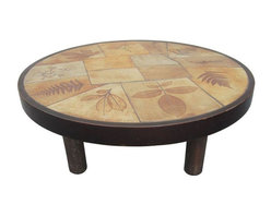 """Vallauris - Pre-owned R. Leduc Vallauris """"Garrigue"""" Coffee Table - Inlay it on us with his Mid-Century coffee table from Vallauris in the south of France. It features """"Garrigue"""" ceramic tiles with impressed leaves that are inset into a round walnut frame. The table is signed """"R. Leduc Vallauris."""""""