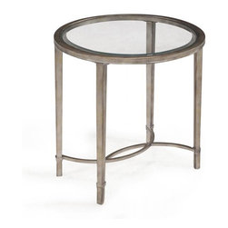 Magnussen Home Furnishings - Copia Antique Silver Glass-top Oval End Table - The Copia end table features a swooping metal tube frame finished in elegant antique silver. This lovely accent table is topped with a sleek 5 mm clear tempered glass surface.