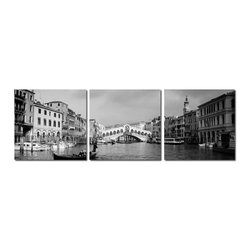 Baxton Studio - Baxton Studio Rialto Bridge Mounted Photography Print Triptych - Venice??????s famed Rialto Bridge sits front and center as tourists and locals alike fill the Grand Canal. Black and white make this MDF wood-mounted photo print feel timeless and classic. A single photograph stretches across three separate frames, each printed with a portion of the image on a waterproof vinyl canvas sheet. Made in China, this modern wall art collection is fully assembled, requires mounting hardware, but is otherwise ready to hang. To clean, we recommend dry dusting.