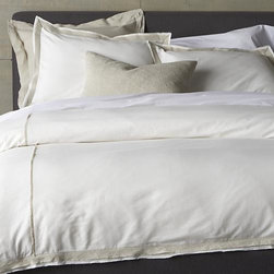 Bianca King Duvet Cover - Linen and cotton seam up as neutral naturals with a modern edge. Duvet cover stitches up white panels with a natural colored fabric at the seam and along the edge, frayed for a casual, artisanal feel. Cover reverses to solid white and includes a hidden button closure and interior fabric ties to secure the duvet. Duvet insert also available.