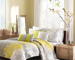 Madison Park - Madison Park Lola 6-piece Quilted Coverlet Set - Lola is the perfect solution to an updated, modern print look. This comforter collection features an overscaled floral print design printed on 100% cotton fabric for a super soft hand feel. Features: -Full / Queen size includes 1 coverlet, 2 standard shams and 3 decorative pillows. -King size includes 1 coverlet, 2 king shams and 3 decorative pillows. -Lola collection. -Color: Yellow / grey. -Material: 100% Cotton printed. -180 Thread count cross weave reverse on comforter. -Self fabric binding. -Reverse of the coverlet is a clean white color that coordinates with the grey. -Overscaled floral print design for a super soft hand feel. -Decorative pillows embroidery and piecing details.